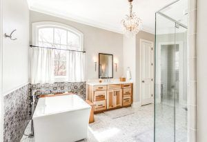 Gray Bathroom with Soaking Tub and Glass Shower