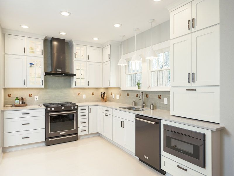 White Kitchen with Gray Backsplash