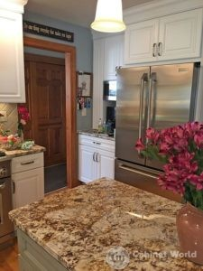 White Kitchen Cabinets with Stainless Steel Fridge